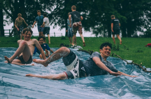 Teens on waterslide
