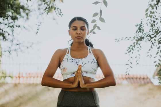 zen prayer hands relaxed girl